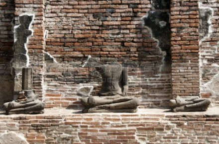 13689958-headless-buddha-ruins-at-the-temple-of-wat-chai-wattanaram-in-ayutthaya-near-bangkok-thailand